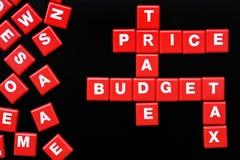 Die Wörter PREIS, BUDGET, HANDEL und STEUER buchstabierten mit Buchstaben Stockbild