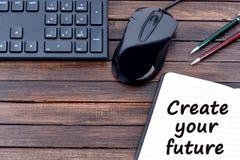 Die Wörter schaffen Ihre Zukunft auf Notizbuch Lizenzfreie Stockfotos