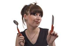Die wütende Hausfrau mit Messer und Löffel Lizenzfreies Stockbild