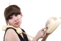 Die wütende Hausfrau mit Telefon Stockfoto