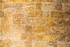 Die Wand der Sandsteinbeschaffenheit Lizenzfreies Stockfoto