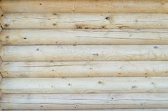 Die Wand des Holzhauses Stockfoto