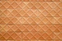 Die Wand verziert mit alten Terrakottafliesen Lizenzfreie Stockfotos