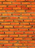 Die Wand vom Ziegelstein und vom Ziegelsteinhintergrund, roter Backstein und Muster des Backsteinmauerhintergrundes Stockbild