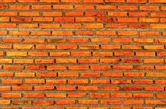 Die Wand vom Ziegelstein und vom Ziegelsteinhintergrund, roter Backstein und Muster des Backsteinmauerhintergrundes Lizenzfreie Stockfotografie