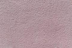 Die Wand wird vom Gips und von gemalter Rosa- oder Beigefarbe hergestellt Lizenzfreie Stockbilder