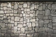 Die Wand wird von den Fragmenten der Denkmäler hergestellt Lizenzfreies Stockfoto
