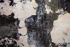 Die Wandbeschaffenheit mit gebrochenem Gips und Tünche Stockfotografie