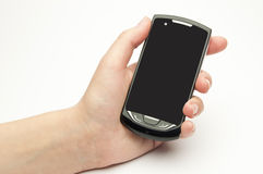Die weibliche Hand hält einen Handy an lizenzfreies stockfoto