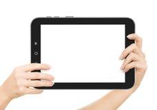 Die weiblichen Hände, die eine Tablette halten, berühren Computergerät mit stockfotografie