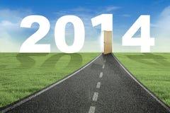 Die Weise zur Tür neuen Jahres 2014 Lizenzfreie Stockfotos