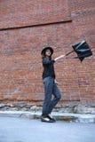 Die wellenartig bewegende Tasche des Mädchens Lizenzfreies Stockfoto