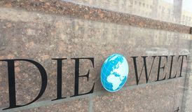 Die Welt daily newspaper sign. Berlin, Germany - January 24, 2017: Die Welt sign outside a newsstand. Die Welt German for the world is a German national daily stock image