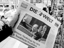 Die welt reporting handover ceremony presidential inauguration o. PARIS, FRANCE - MAY 15, 2017: Man buys German Die Welt newspaper reporting handover ceremony Royalty Free Stock Photography