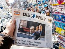 Die welt reporting handover ceremony presidential inauguration o. PARIS, FRANCE - MAY 15, 2017: Man buys German Die Welt newspaper reporting handover ceremony Stock Image
