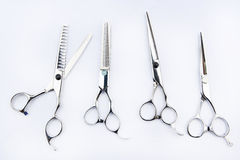 Die Werkzeuge des Friseurs lokalisiert auf Hintergrund Stockfotografie