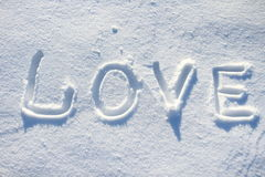 Die Wortliebe gezeichnet in den Schnee Lizenzfreie Stockfotografie