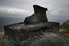 Die with your boots on. This boots made on metal are sited in the Finisterre's Lighthouse, in the Costa Da Morte, Galicia, province of Spain. Is a representative Stock Photo