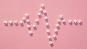 Die Zahlen von Pillen auf dem Hintergrund stockfoto