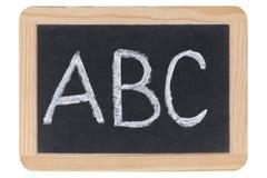 Die Zeichen ABC auf einer Tafel an der Schule Stockfotografie