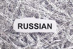 Die zerrissene Nahaufnahme bessert und Bänder des Papiers mit dem Wort RUSSE aus Lizenzfreies Stockbild