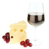 Die Zusammensetzung der Imbisse des Käses, des Weins und der Trauben. Stockbild