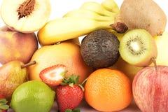 Die Zusammenstellung von den exotischen Früchten lokalisiert auf Weiß Lizenzfreies Stockfoto