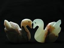 Die zwei Figürchen des Schwans Stockfoto