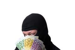 Dieb, der Geld lokalisiert auf weißem Hintergrund hält Stockbild