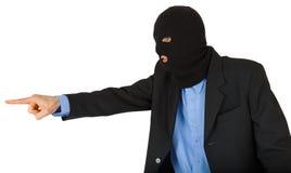 Dieb in der schwarzen Maske im Anzug zeigend mit seinem Finger Stockfotos