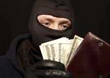Dieb mit einem Geldbeutel Lizenzfreie Stockbilder
