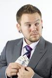 Diebstahl des Geldes Lizenzfreie Stockbilder