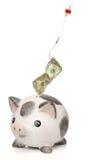 Diebstahl des Geldes von einer piggy Querneigung Stockfoto
