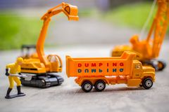 Diecast Construction Toys. Excavator Toys, Dump Truck, Lifting Crane and Construction Worker with Shovel Royalty Free Stock Photos