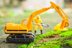 Diecast Construction Toys, Excavator Toys and Construction Worke. R with Shovel Stock Images
