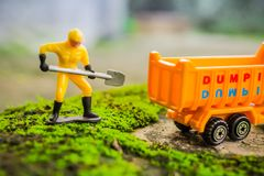Diecast Construction Toys Macro. Diecast Construction Toys Lift Soil to Dump Truck Toys Stock Images