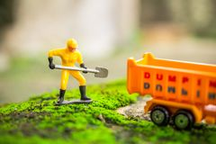 Diecast Construction Toys with Worker Shovel Lift Soil to Dump Truck Toys. Diecast Construction Worker Toys with Shovel Lift Soil to Dump Truck Toys Royalty Free Stock Images