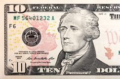 Dieci dollari di frammento della fattura di U S soldi nella macro Immagine Stock Libera da Diritti