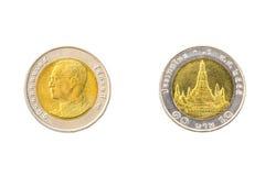 Dieci monete tailandesi di baht Immagini Stock