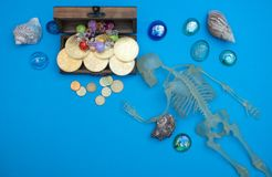 Died pirate near old chest with treasures. Skeleton of died captain pirate near old chest with treasures. coins, gems, gold. hidden hoard at caribbean island stock images