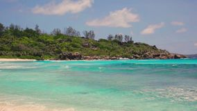 Died tree and small waves in white beach at Seychelles islands. La Digue, Anse Cocos stock footage