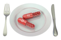 Dieet en gezond maaltijdconcept Plaat met de capsules van ijzerfe, 3D r Royalty-vrije Stock Afbeelding