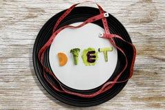 Dieettekst met maatregelenband op de plaat Stock Foto