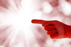 Dien de handschoen tegen van achtergrond zonstralen close-up in Royalty-vrije Stock Afbeelding