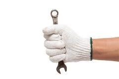 Dien handschoen in houdend een moersleutel Stock Foto