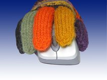 Dien handschoenen op een muis in Stock Fotografie