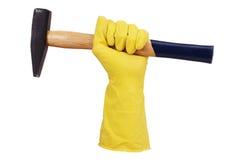 Dien rubberhandschoen met een hamer in Royalty-vrije Stock Fotografie