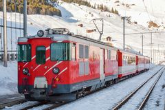 Matterhorn Gotthard railways train waiting in Dieni train station in Switzerland. DIENI, SWITZERLAND - FEBRUARY 9, 2018: Matterhorn Gotthard railways train Royalty Free Stock Photography