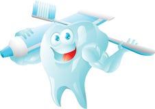 Diente fuerte con el cepillo de dientes y la crema dental Fotografía de archivo