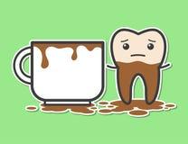 Diente y taza de café Imagen de archivo libre de regalías
